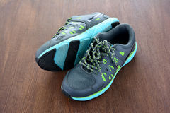 Gray sport shoes on wooden background. Stock Photo