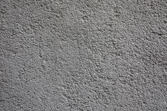 Gray spotted a concrete wall, background, texture royalty free stock photography