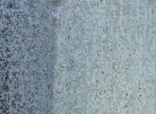 Gray steel background. Metal surface with dots and scratches. Retro wallpaper - aged steel surface stock image