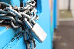 Gray steel chain locked on gate stock photos