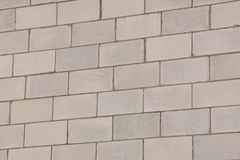 Gray stone texture from a brick wall of a house Royalty Free Stock Photo