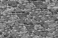 Gray stone background texture uneven weathered base hard substrate design geological lot of cobblestone stock photo