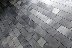 Gray stone floor. Close-up of a gray stone tiled floor stock photos