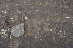 Gray stone lies on the board in the ground royalty free stock photos