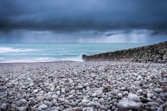 Gray Stone Near Blue Ocean Waves and Green Trees Royalty Free Stock Photo
