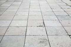 Gray stone pavement perspective, square floor tiling Stock Images