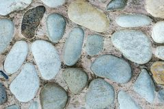 Gray stone paving stones from round stones Gray background royalty free stock image