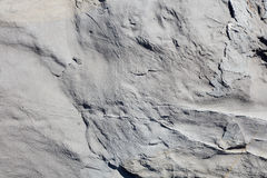 Gray stone rock texture background in sunlight royalty free stock photo