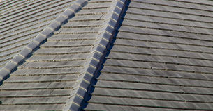 Gray stone roof tiles Stock Photography