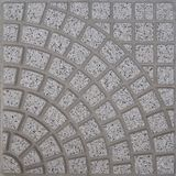 Gray stone square tile for exteriors made by quadrilaterals forming a fan shape pattern Stock Photography