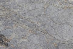 Gray stone surface with stripes. Grunge abstract stone surface. This is a horizontal background. Gray stone surface with stripes. Grunge abstract stone surface stock image