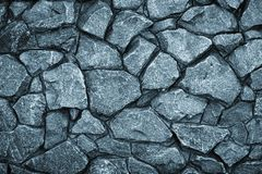 Free Gray Stone Wall Background. Mosaic Of Bricks In Retro Style, Modern. Dark Rock Texture, Brick Wall Pattern. Grey Grunge Surface Stock Photos - 167616763
