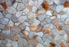Gray stone wall with built Stock Photography