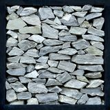 Gray stone wall . Gray stone wall with black steel frame Stock Photography