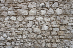 Gray stone wall textured background. Urban gray stone wall textured background Stock Image