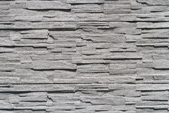 Gray stone wall. Textured gray stone wall pattern. Background image Royalty Free Stock Photos