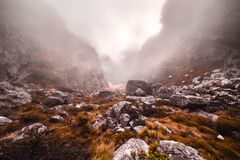 Gray Stones in Grassy Mountains during Foggy Day Stock Images