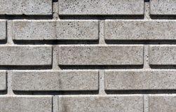 Gray stylized brick wall texture. Stock Image