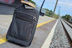 Gray suitcase on the railway platform Stock Photos