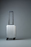 Gray Suitcase on Wheels Royalty Free Stock Images