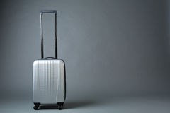 Gray Suitcase on Wheels Stock Photography