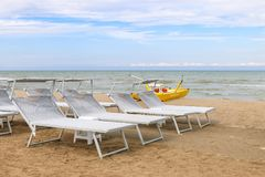 Gray sunbeds on the beach, Italy, Riccione royalty free stock image