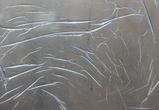 Gray surface covered with a thin transparent protective film. As a background royalty free stock images