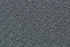 Gray swatch of textured carpet. royalty free stock images