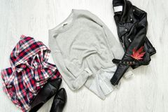 Gray sweater, black jacket, checkered scarf and shoes. Fashionab Royalty Free Stock Images