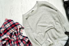Gray sweater and checkered scarf. Fashionable concept Stock Photography