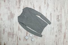 Gray sweater and silver boxes on a wooden background. Fashionabl. E concept Stock Photography