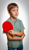 Gray table young boy fun sport play tennis racket playing ping p Stock Image
