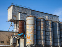 Gray tall tanks on old concrete factory Stock Photo