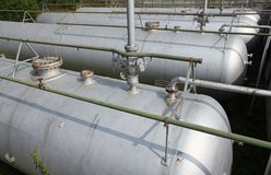 Gray tanks and huge cistern the storage of gas and liquids Royalty Free Stock Photo