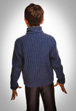 Gray teenage boy standing with his back on white backgr stock images