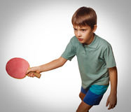 Gray tennis table young boy fun sport play racket playing ping p Royalty Free Stock Photography