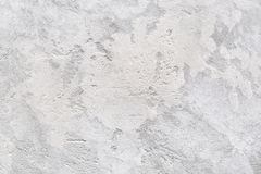 Gray Texture of concrete or plaster wall Abstract background. Patchy gray texture of rough concrete wall or abstract plaster pattern. Light gray background stock photo