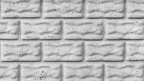 The gray texture of a concrete wall with cracks, imitation of stone blocks or bricks, architecture abstract background. Gray texture of a concrete wall with stock photos