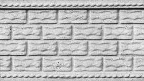 The gray texture of a concrete wall with cracks, imitation of stone blocks or bricks, architecture abstract background. Gray texture of a concrete wall with royalty free stock photo
