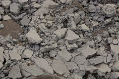 Gray texture of dry earth in a heap. Gray background of dry sand in a pile stock photography