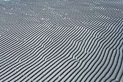 Gray texture waves sea sand Stock Photos