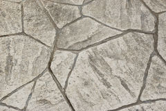 Gray Textured Patio Stone. Gray Textured and Cracked Patio Stone Background Royalty Free Stock Photography