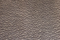 Gray textured plaster wall close-up Stock Image