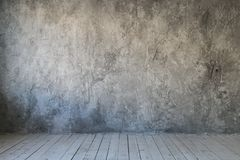 Gray textured wall of concrete and wood floor. Free space for text stock photos