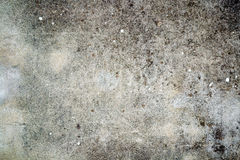 Gray textured wall with dark stains Stock Photography