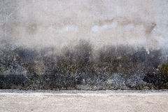 Gray textured wall with dark stains. Gray texture of wall with some dark stains with visible bottom line Stock Photo