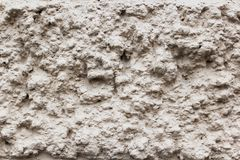 Gray textured wall of uneven old dirty plaster stock photography