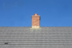 Gray tile roof and chimney Stock Photo