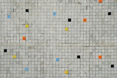 Gray tiled mosaic wall with random color pattern background Stock Photo