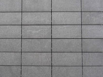 Gray Tiles Background. A background with a wall made of a pattern of gray tiles Stock Images